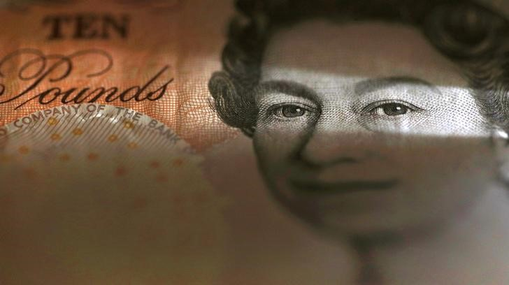 An English ten Pound note is seen in an illustration